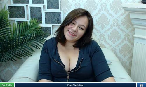 Playful curvy girl giggles for the camera on ImLive.com
