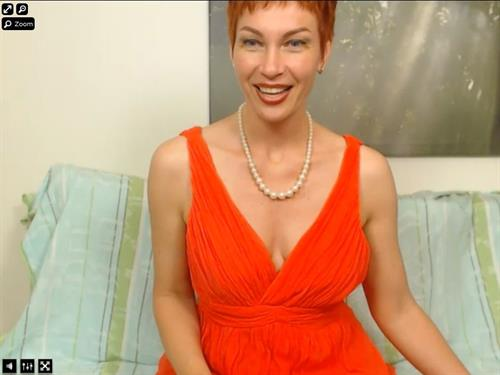 Short haired mature redhead on cam